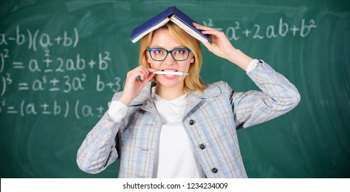 Keep information knowledge on mind. Head as storage of information. Data storage in memory. Knowledge storage concept. Woman teacher with book as roof on head. Memorizing method and activity.