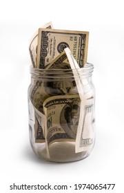 Keep money in glass jar - banka but not bank. Saving money or deposit program concept - Shutterstock ID 1974065477