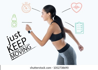 Keep moving. Responsible enthusiastic young woman feeling happy and fixing her health condition while running