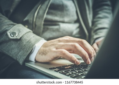 I keep my job in my hand. Close up human hands. Business man working on laptop in car.