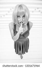 Keep my secret. Sexy girl keep finger on lips, top secret. Sexy girl with crazy look. hidden information concept. womens secret. A bit crazy about secrecy.