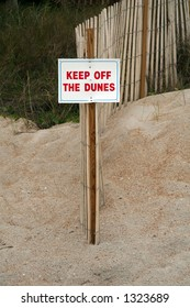 Keep off the dunes sign at the beach