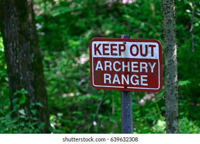 Keep out, archery range sign in the woods.
