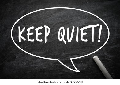 Keep Quiet word on a blackboard with chalk