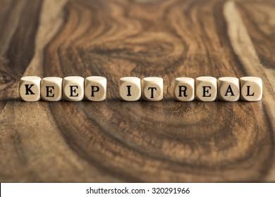 KEEP IT REAL word background on wood blocks