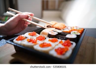 keep roll with chopsticks, rolls, sushi