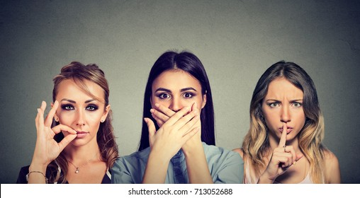 Keep a secret be quiet concept. Three secretive woman keeping mouth shut.