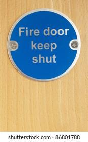 Keep shut sign on fire door