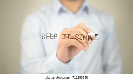 Keep it Simple,  Man writing on transparent screen