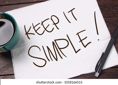 Keep it Simple. Motivational inspirational quotes words. Wooden background