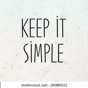 Keep it simple phrase on mulberry paper texture background