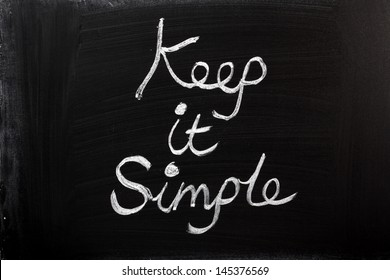 Keep It Simple written in chalk on a used blackboard. A well known saying for business strategy, project management and planning.