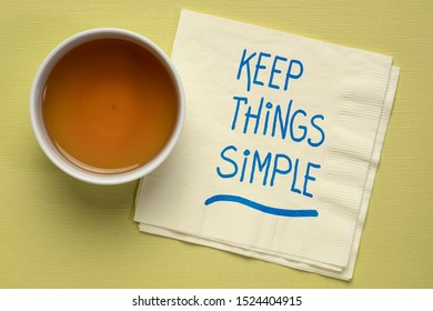 keep things simple - handwriting on a a napkin with a cup of tea, simplicity,  minimalism or lifestyle concept