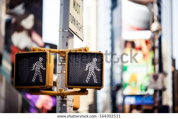 Keep walking New York traffic sign with illuminated and blurred background