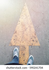 Keep walking, shoes and arrow.