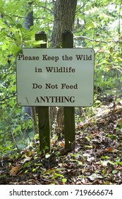 KEEP THE WILD IN WILDLIFE - DO NOT FEED ANYTHING sign in state park. Vertical.