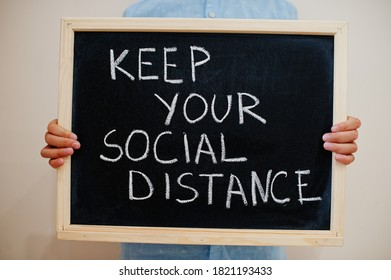 Keep your social distance. Coronavirus concept. Boy hold inscription on the board.