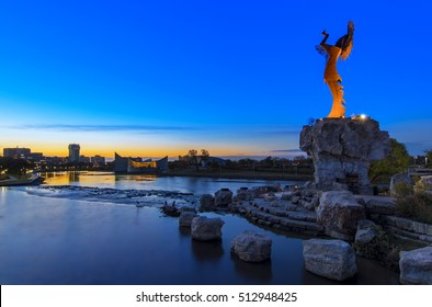 Keeper of the Plains Indian in Wichita, Kansas at sunrise. A steel sculpture by Blackbear Bosin that stands at the fork of the Arkansas River.
