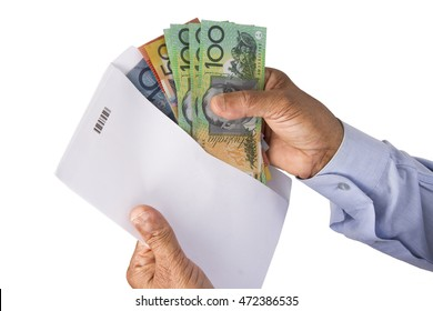 Keeping Australian dollars money in envelope or in a cover on a white isolated background.