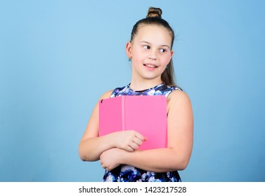 Keeping her secrets in diary. Child cute girl hold notepad or diary blue background. Childhood memories. Note secrets down in cute girly diary journal. Diary for girls concept. Keeping secrets here.