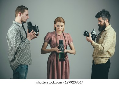 Keeping your best memories. Photography studio. Retro style woman and men hold analog photo cameras. Group of photographers with retro cameras. Paparazzi or photojournalists with vintage old cameras.