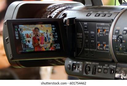 KEESRAGUTTA,HYDERABAD,INDIA-FEBRUARY 24:TV reporter with cameraman cover Hindu God  Shiva Mahasihvaratri fesival celebration, near temple,on February 24,2017 in Hyderabad,