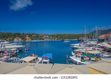 KEFALONIA - GREECE, AUGUST 2018: Scenic view of Fiscardo village and the port during Summer. Fiscardo is a picturesque fishing village located on the northern most tip of Kefalonia island, Greece