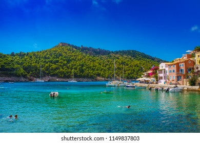 KEFALONIA,GREECE, AUGUST 2018: The majestic coastal village of Assos in Kefalonia island. Amazing colors and beautiful traditional buildings in the picturesque village Assos. Kefalonia, Greece Europe.