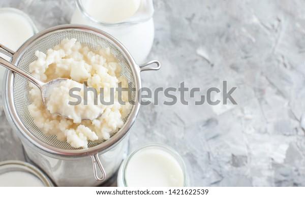 Kefir grains and  fermented drink kefir close up