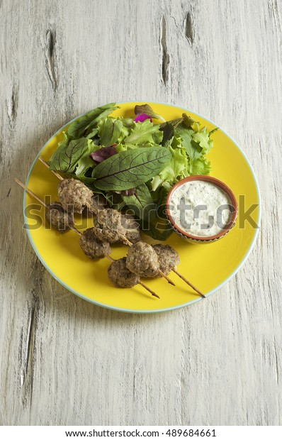Keftedes, greek veal meatballs served with tzatziki sauce