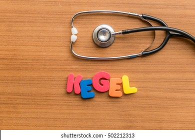 Kegel colorful word with Stethoscope on wooden background