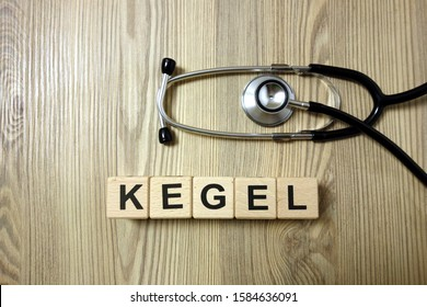 Kegel word with stethoscope on wooden desk background