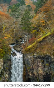 The Kegon Falls near Nikko, Japan surrounded by autumn colors