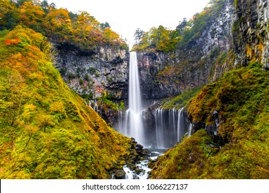 Kegon Waterfall in autumn trees colorful waterfall from lake Chuzenji in Nikko national park , against white isolated sky , Beautiful in autumn season at Tochigi,Japan - Shutterstock ID 1066227137