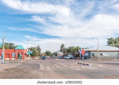 KEIMOES, SOUTH AFRICA - JUNE 12, 2017: A street scene with businesses and vehicles in Keimoes in the Northern Cape Province
