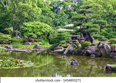 Keitakuen Garden, traditional Japanese garden in Osaka, with lake, sacred lanterns, flowers, stones