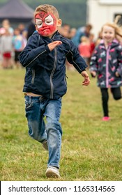 KEITH, MORAY, SCOTLAND – 12 AUGUST 2018:- This is one of the children taking part in a race at the Keith Country Show, Moray, Scotland on 12 August 2018.