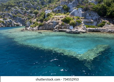 KEKOVA ISLAND, TURKEY - JULY 23, 2014 : A section of the Sunken City showing Byzantine ruins off Kekova Island in the Mediterranean Sea. The city sunk into the sea after earthquakes in 2nd century AD.
