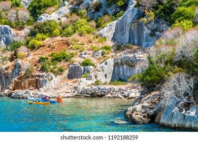 Kekova Island, Turkey - September 11, 2018 : People are kayaking on Simena sunken city in Kekova Island of Turkey.