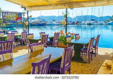 KEKOVA, TURKEY - MAY 10, 2017: Coast of Ucagiz is occupied with cafes, fish restaurants, travel agencies and hotels with picturesque views on sea, mountains and yachts, on May 10 in Kekova.