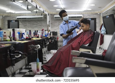 Kelana Jaya,Petaling Jaya,Selangor,Malaysia - circa September 2017 : a young asian boy having haircut at local barber shop.Majority of the barber shop in malaysia is run by Indian.