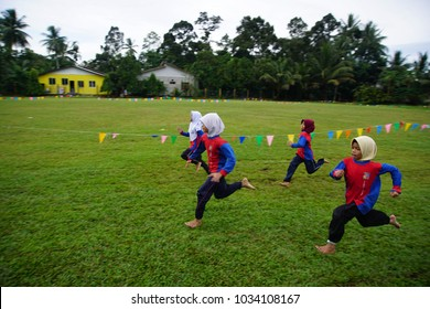 Kelantan Malaysia 12 FEB 2018 : Malaysian kids running in school in sport activity program learning with friends and teacher on the back