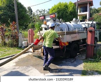 Kelantan Malaysia - 12/7/2019:Emptying household septic tank. Cleaning and unblocking clogged drain