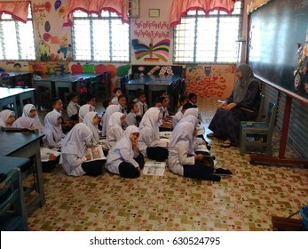 KELANTAN ,MALAYSIA - 30/04/2017 :Attentive children sitting with teacher and having conversation in class at school in Malaysia.