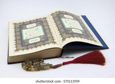 Kelantan, Malaysia - February 2, 2017 ; The Holy Quran with stone tasbeeh.