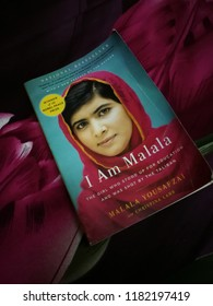 Kelantan  Malaysia, Jul 2018: Book of  Malala Yousafzai Pakistani activist for female education and the youngest Nobel Prize laureate on the red and black background.