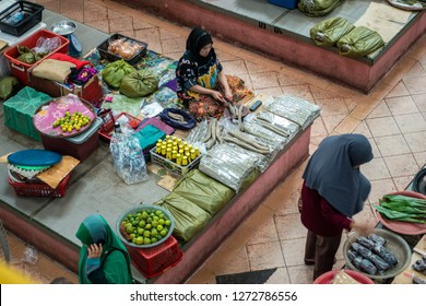 "Kelantan, Malaysia -September 2018: Fish Cracker or ""keropok lekor"" seller at Siti Khadijah Market, a famous indoor market for tourists and locals located in the city of Kota Bahru."