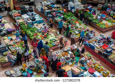 Kelantan, Malaysia -September 2018: Locals buying vegetables at Siti Khadijah Market, a famous indoor market for tourists and locals located in the city of Kota Bahru.
