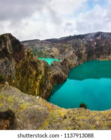 Kelimutu, Three multicolored cratered acid lakes that periodically change their color - Flores Island, Indonesia
