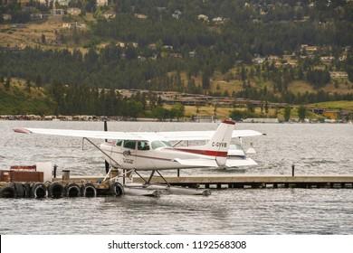 KELOWNA, BRITISH COLUMBIA, CANADA - JUNE 2018: Cessna 172 float plane tied up alongside a wooden jetty in Kelowna, British Columbia.